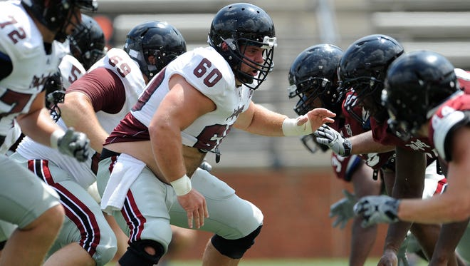 Lineman Caleb Carbine (60) during the Troy University football scrimmage in Troy, Ala. on Saturday August 9, 2014.