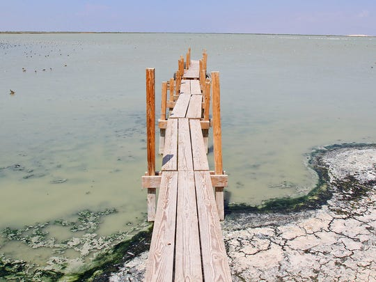 A boat dock sits in just inches of water at the southeastern edge of the Salton Sea, Thursday, August 22nd, 2013. Jay Calderon/The Desert Sun
