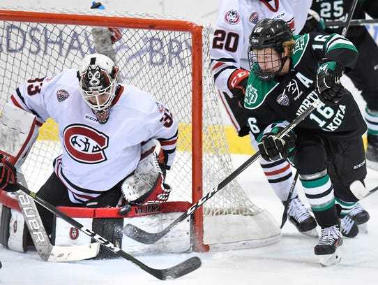 St. Cloud State goalie Zach Driscoll blocks a shot