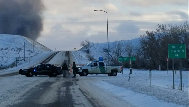 Highway 87 has been blocked outside of Havre due to a large fire.