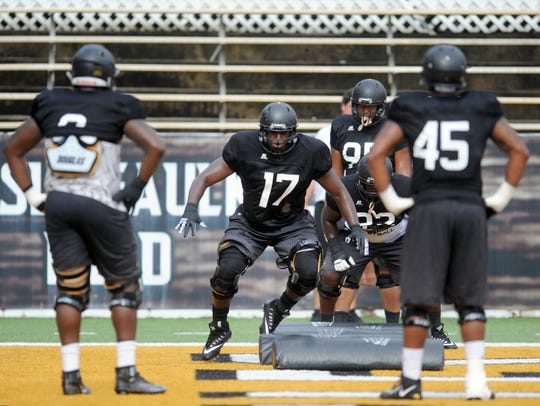 Southern Miss defensive lineman Delmond Landry gives