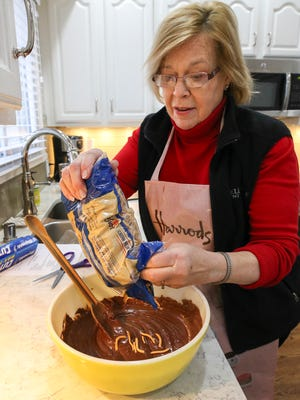 Gail Henson prepares Tingalings, a no-bake cookie from a recipe that has been handed down for generations.
