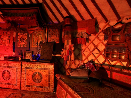 'Ger': A standard Mongolian nomadic home of felt and wood with antique home artifacts.