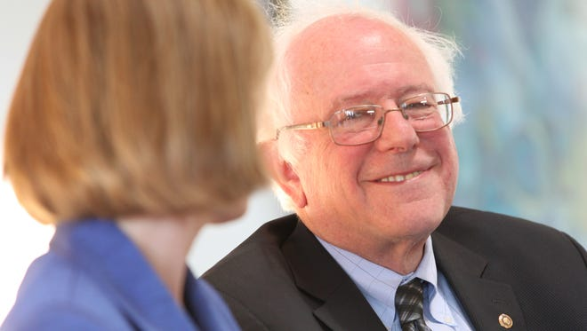 Sen. Bernie Sanders, I-Vt., smiles at a remark by federal Health Resources and Services Administration Administrator Mary Wakefield during a news conference Thursday in Burlington regarding access to health care and the use of community health centers.