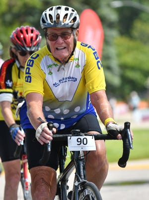 """Rodger Nelson rides in the 2017 Scenic Shore 150 with the number """"90"""" on his bike, since he turned 90 during the two-day ride. The 150-mile tour stretches from Milwaukee up to Door County along Lake Michigan."""