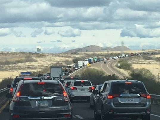 Traffic backed up for miles after vehicle rollover