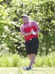 Rutland's Jared Nelson watches his drive on the 11th