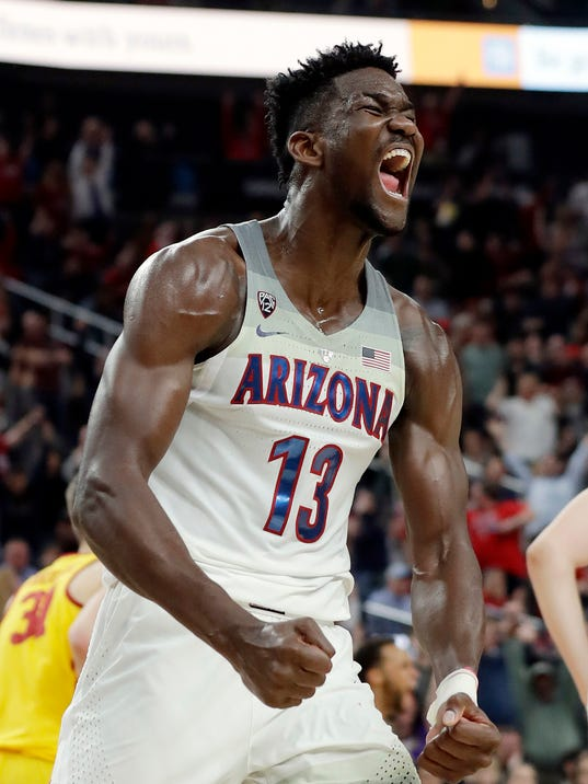 Arizona's Deandre Ayton reacts after a dunk against Southern California during the second half of an NCAA college basketball game for the Pac-12 men's tournament championship Saturday, March 10, 2018, in Las Vegas. Arizona won 75-61. (AP Photo/Isaac Brekken)