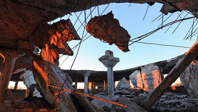 A single column stands amid the rubble of a collapse in building #92 at the southern end of the Packard plant in October, 2010. On top of it is a TV, which was placed there by artist Scott Hocking in an installation he called Garden of the Gods.