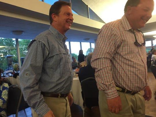 Dr. Corky Davis, left, shares a laugh with a friend