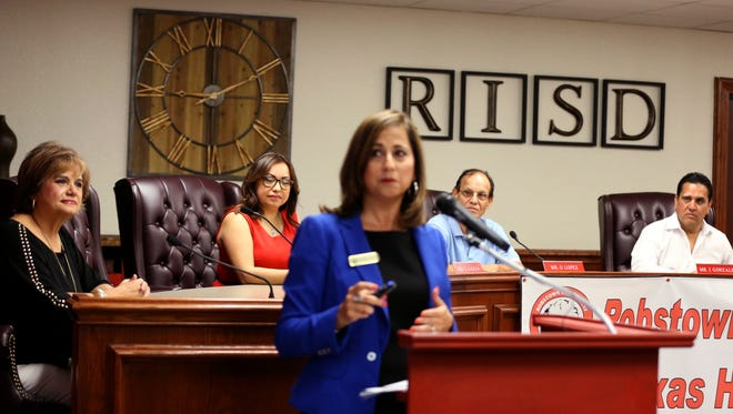 Maria Vidaurri (center), superintendent of the Robstown Independent School District, speaks during an announcement on Wednesday, August 3, 2016, that the board of trustees, including Bertha Roldan (from left), Lori Ann Garza, Oscar Lopez and Ismael Gonzalez, that the board was named as one of five honor school boards by the Texas Association of School Administrators.