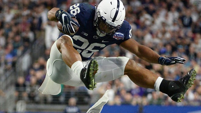 Saquon Barkley expects to wow NFL officials with his skills during Friday's on-field workout in Indianapolis. Barkley hopes to use the NFL Combine as a means to cement his prediction as a Top Five pick in the upcoming draft. Here, he leaps over Washington defensive back Austin Joyner and linebacker Keishawn Bierria during the Lions' Fiesta Bowl victory.