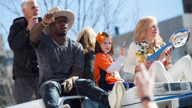 Denver Broncos linebacker and Super Bowl MVP Von Miller waves to fans along 13th Ave. in Denver during a Super Bowl championship celebration parade Tuesday, February 9, 2016.
