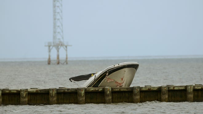A boat rests on the jetty near the entrance to the 17th Avenue boat launch Sunday.