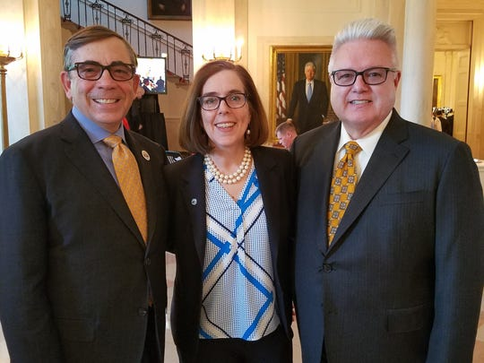 From left, Palm Springs Mayor Robert Moon, Oregon Gov. Kate Brown and Moon's husband Bob Hammack in the foyer outside the East Room at the White House for the LGBT Pride reception with President Barack Obama.