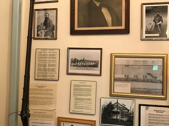 The Civil War Drill Hall in Leonia holds artifacts from its Civil War origins, including portraits of officers and soldiers trained there, a Civil War rifle and a rifle rack built into the shelf.
