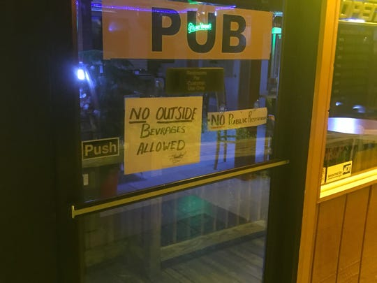 A sign barring patrons from bringing alcohol into the Salty Bear Raw Bar in Gatlinburg on Aug. 21, 2017.