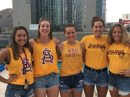 Ruby Martin (middle) poses with Arizona State swimmers