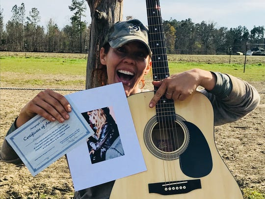 Fairland Ferguson received this guitar, signed by Taylor Swift, anonymously Sunday afternoon. She's has no idea who sent it or why it was sent.
