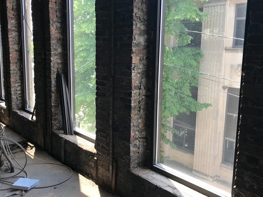 Large windows overlook the downtown. Kari Koenigs hopes to keep the exposed brick during the expansion.