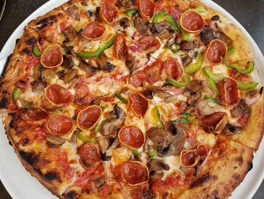 The Empire pizza ($15) is topped with pepperoni, mushrooms,