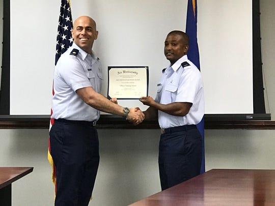 1st Lieutenant Kenneth Ellison receives his diploma