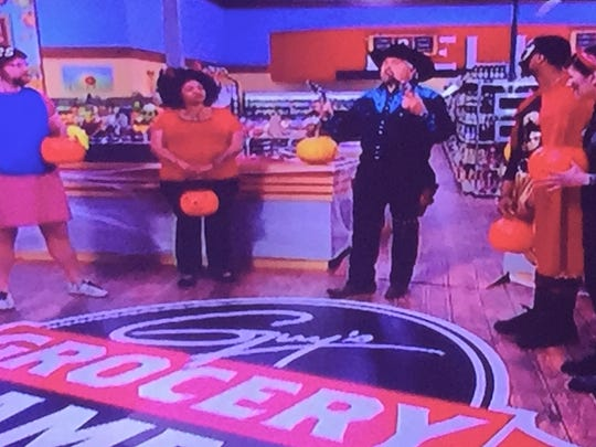 """A Halloween episode of host/chef Guy Fieri's Food Network TV show """"Guy's Grocery Games"""" called for the contestants and host to wear costumes."""