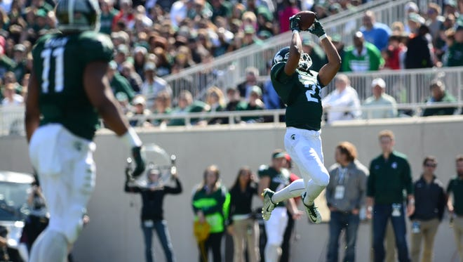 Green team wide receiver Cam Chambers makes the catch during the Green and White Spring Game on Saturday, April 23, 2016 at Spartan Stadium.