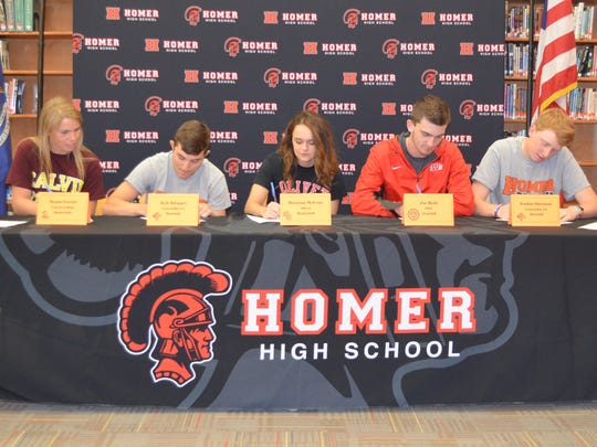 Seven athletes from Homer High School signed to play
