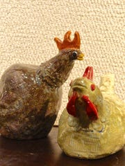"""Ceramic artworks """"Man of the House"""" by Cierra Johnson, left, and """"Rustic Rooster"""" by Mary LaPlant, right, both of Sevastopol High School, part of the 41st Annual Salon of Door County High School Art at the Miller Art Museum."""