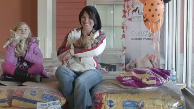 Samantha White of Weaverville and her daughter Alexia Stroud, 7. White received $25,000 from TD Bank to spend in 24 hours, which she used to buy pet food to donate to area shelters.