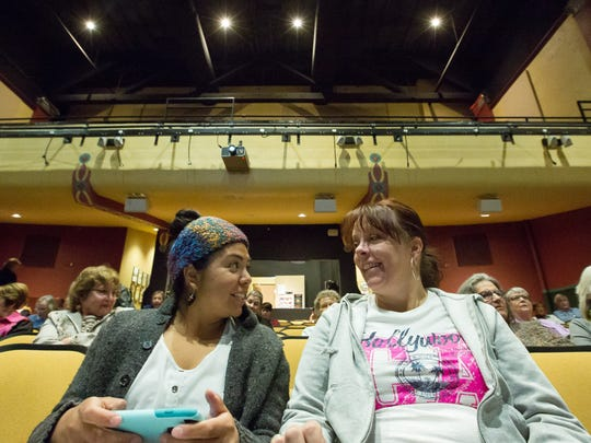 """Marissa Coronado, left, and Dawna Bennett chat before the start of the screening of """"Awaken in Taos"""" at the Rio Grande Theatre on Sunday, February 26, 2017. Bennett, who is a Doña Ana Community college student, said she was excited for the students workshop held at the end of the screening, """"I want to look into the film crew certificate program at the community college and I want to be in the loop on upcoming film opportunities in Las Cruces,"""" said Bennett."""