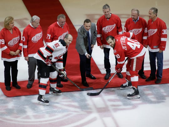 Steve Yzerman drops the ceremonial puck to the Devils'