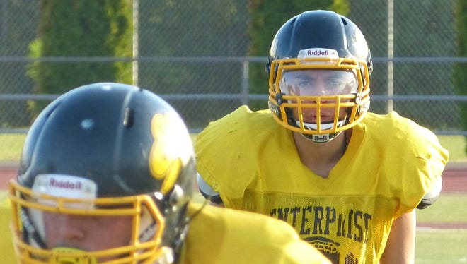 Enterprise linebacker Jordan Khamphaphirath (right) gets ready for a play during Monday's practice.