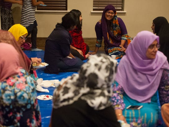 Women socialize and eat during Ramadan iftar, the daily