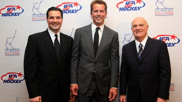 Hockey greats Eddie Olczyk, left, Mike Modano and Lou Lamoriello, right, pose for a photo before the U.S. Hockey Hall of Fame class of 2012 induction dinner in Dallas. Olczyk will be broadcasting both hockey and horse racing this weekend.