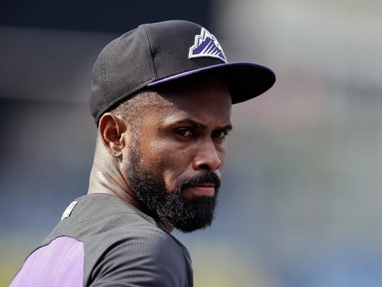 FILE - In this Sept. 9, 2015, file photo, Colorado Rockies shortstop Jose Reyes is shown prior to a baseball game against the San Diego Padres, in San Diego. The New York Mets have signed Reyes to a minor league contract, Saturday, June 25, 2016.  Reyes, 33, played primarily at shortstop for the Mets from 2003-11, but may be used in a utility role in his reunion with the team. He was cut by Colorado after serving a 59-day suspension for violating Major League Baseball's domestic violence policy. (AP Photo/Gregory Bull, File)