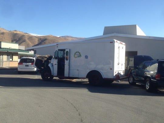 A Model Dairy truck that broke down blocks handicapped parking at Verdi Elementary Friday.