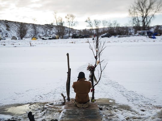 Army veteran Nick Biernacki, of Indiana, prays at the Cannonball River at the Oceti Sakowin camp where people have gathered to protest the Dakota Access oil pipeline in Cannon Ball, N.D. on Dec. 4.