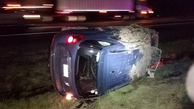 A car flipped several times after striking a large band saw in the roadway on Interstate 5 Tuesday, November 14, 2017.