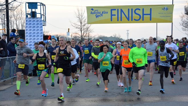 Runners cross the finish line at a previous Special Kids Race. Proceeds benefit the pediatric nursing care and rehabilitation facility.