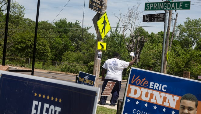May 01, 2018 - Patrick Featherson waves to cars while campaigning for Tami Sawyer at Springdale Baptist Church on Election Day on Tuesday.