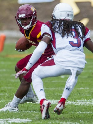 Tuskegee's Ladarrell Pettway (10) is defended by Lane's Brandon Banks (3) in Tuskegee, Ala., on Saturday September 24, 2016.