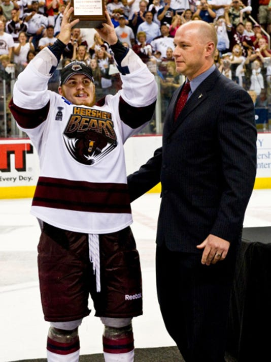Chris Bourque, shown here raising the Calder Cup playoff MVP trophy in 2010, returned to the Hershey Bears on Thursday after signing a two-year, two-way contract with the parent club Washington Capitals.