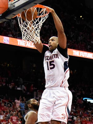 Al Horford dunks the ball against the Nets at Philips Arena.