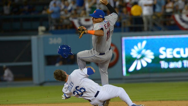 Mets shortstop Ruben Tejada collides with Dodgers' Chase Utley at second base in the 7th inning.