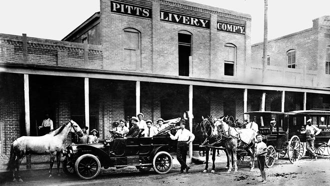 Pitts Livery, the old Fogg's Livery, is shown in 1907. The livery stabled horses, rented buggies, conducted funerals, and serviced the town's first automobiles. It was owned by B.H. Pitts and was located on the site of John Fogg's livery, which dated back to the 1860s. Coleman Furniture was built on this site in the 1930s.