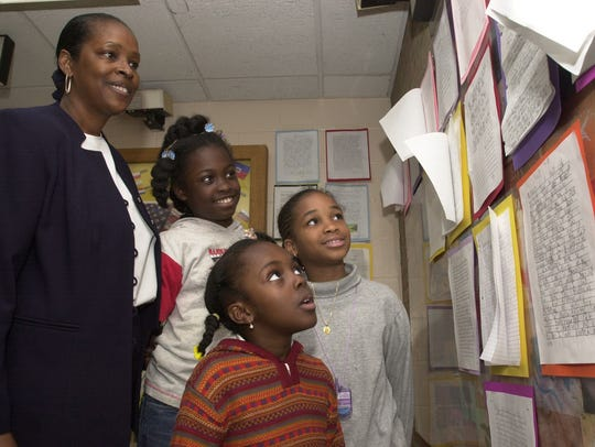 In 2003, Principal Patricia Simmons, with students