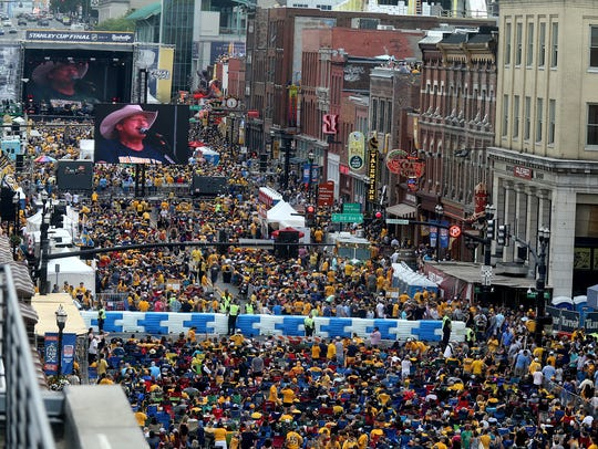Hockey fans cover Broadway, as seen from the roof of