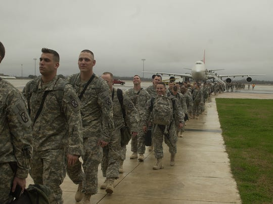 Soldiers based at Fort Polk return from a deployment to Iraq in 2009. Military traffic has remained heavy through England Airpark after its conversion from an Air Force base to a civilian facility.